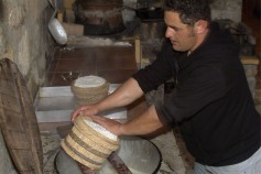 GREECE : CRETE Enagron agro-village, Axos village fresh cheese preparation ©(c) Massimo Pizzocaro