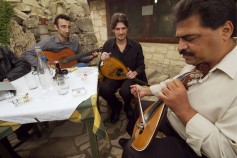 GREECE : CRETE Galanis, traditional lyre (lyra) player jamming with rebetiko players at 'Vamos' Cistern' taverna. Vamos village. ©(c) Massimo Pizzocaro